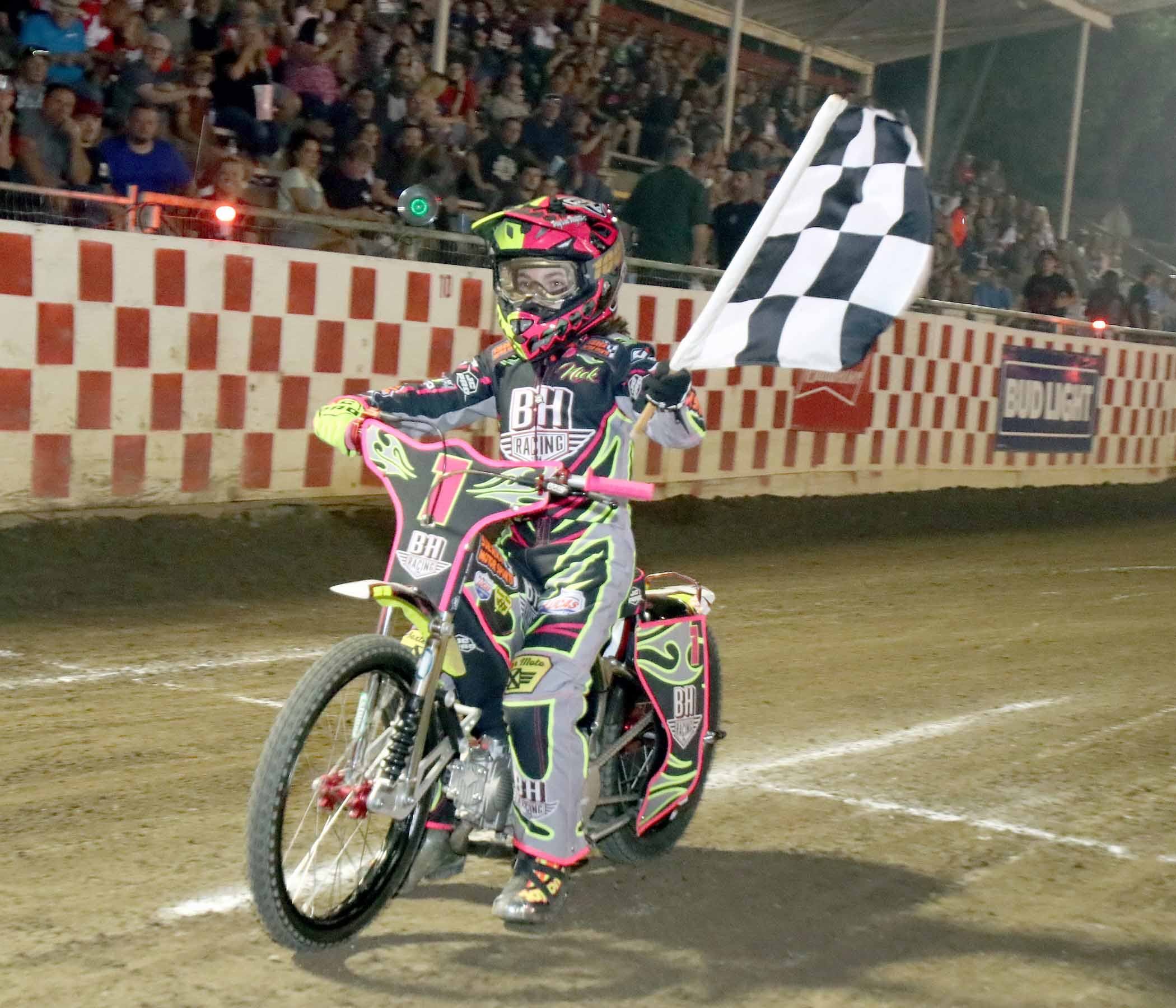 Nick Hohlbein with the checkered flag at Fast Fridays Motorcycle Speedway